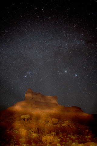 Star photography: Milky Way and painted light on rock formations at Valley of the Gods, Utah