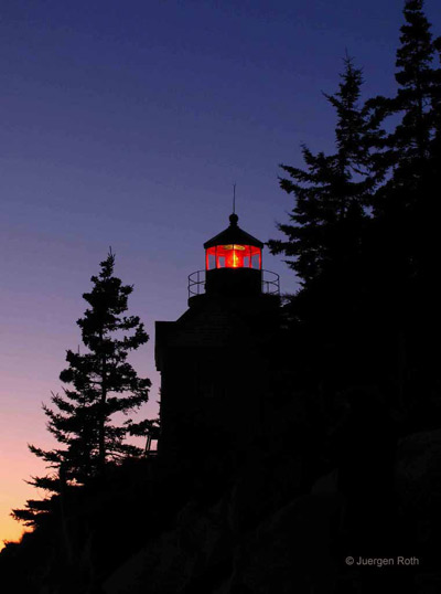 Acadia National Park, Maine: Bass Harbor Lighthouse silhouetted at twilight by Juergen Roth.
