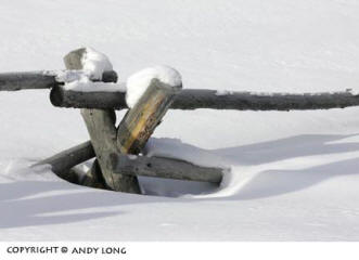 Photo design concepts: fence in snow showing combined elements of shadow, line and texture in a photo by Andy Long.