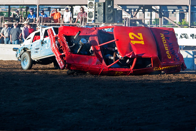 Close-up of cars crashing during a demolition derby by Brad Sharp.