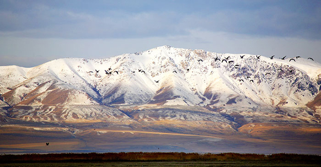 Landscape photo of snow covered Oquirrh Mountains using a polarizing filter by Brad Sharp.