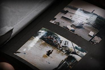 Photo of post tsunami photos in photo album in Sri Lanka by Marielle van Uitert