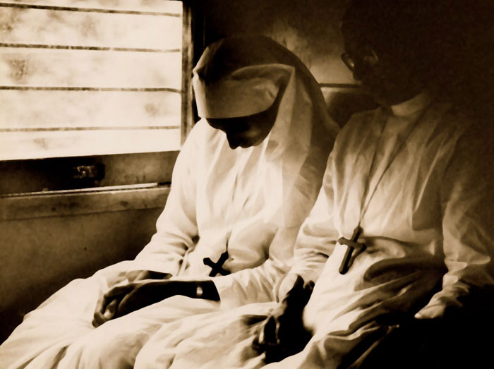 Photo of nuns on Lucknow Mail Express Train, India by Ron Veto