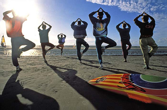 Photo of surf gymnastics on beach by Gert Wagner