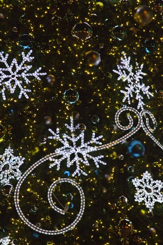 Close-up photo of Christmas tree decorations by Noella Ballenger