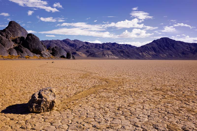 Landscape photo: sliding rock at the Racetrack and The Grandstand in Death Valley National Park by Michael Leggero.