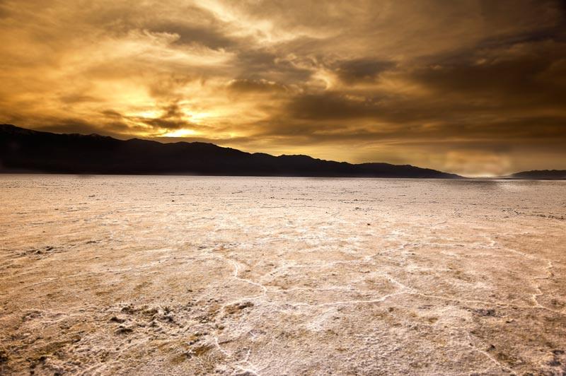 Golden sunrise photo of the salt flats at Death Valley National Park by Michael Leggero.