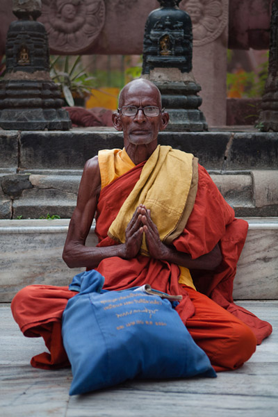 Buddhist monk poses for a photography at Mahabodhi Temple, Bodhgaya, India by Nico DeBarmore.
