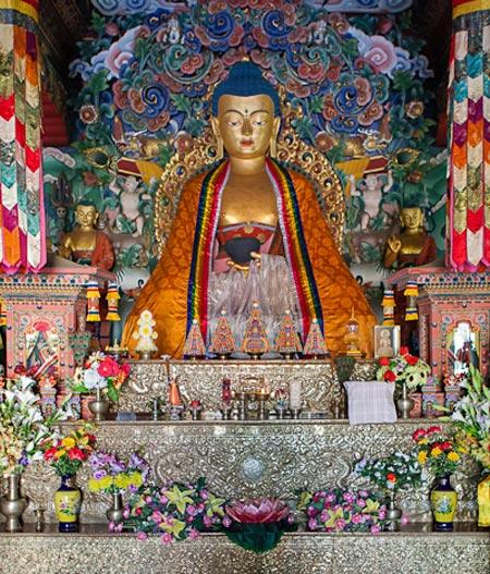 Photo of a gold Buddha in monastery in Bodhgaya, India by Nico DeBarmore