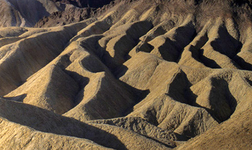 Photo of Death Valley hills with side light showing hard shadows by Noella Ballenger