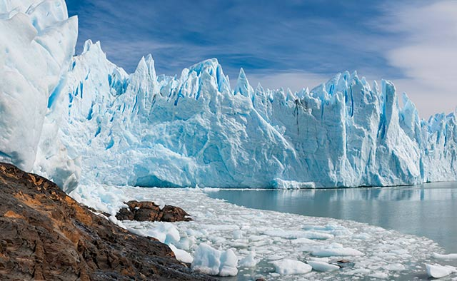 Landscape Photography Mistake and Solution: Glacier, broken ice and water where triangle shapes work in the image by Michael Leggero.