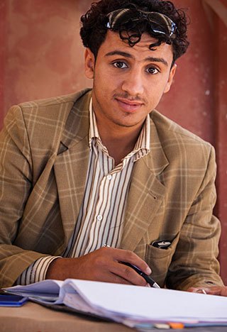 Modern Yemeni dress: A modern young man dressed in modern day clothing by Maarten de Wolf.