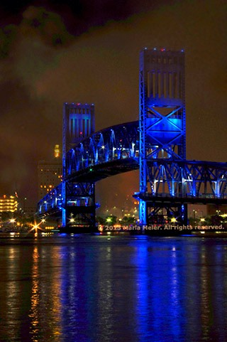 Blue Main Street bridge reflected in the river with fireworks smoke haze in the air by Marla Meier.