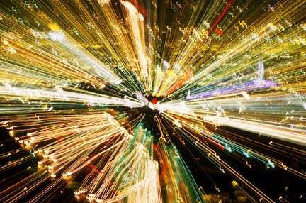 Photo of Christmas lights made while zooming the camera lens like a trombone by Noella Ballenger.