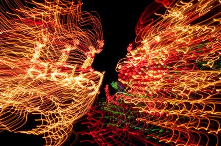 Photo of Santa and reindeer Christmas lights made while wiggling the camera by Noella Ballenger.