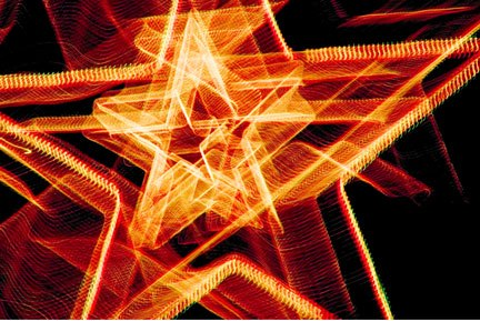 Photo of Christmas lights made while zooming the camera lens on a star by Noella Ballenger.