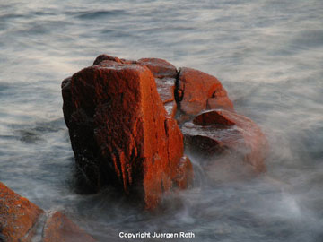 Photo of Granite Coast boulder in water by Juergen Roth.