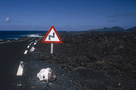 An image of road and road sign where the object connects the foreground and background by Gert Wagner.