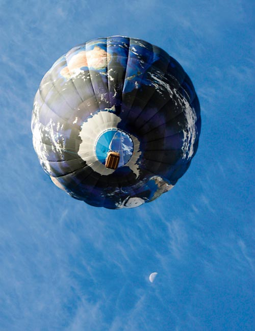 IMAGE TALK: hot air balloon with earth from space scene on it - balloon ascending to striated clouds and early morning moon by Suzanne Cochrane.