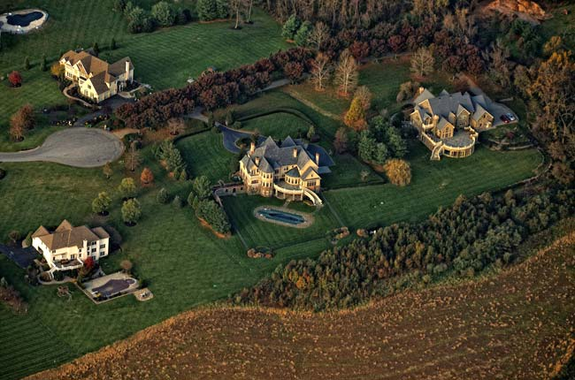 Aerial photography: image of landscape and homes by Allen Moore.