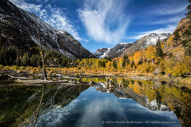 Reflection of mountains on a beaver pond in Lundy Canyon, California by Noella Ballenger.