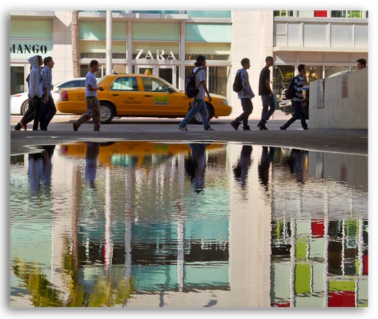 Photo of kids walking & reflection in waterl at South Beach, Miami, Florida by Jim Austin