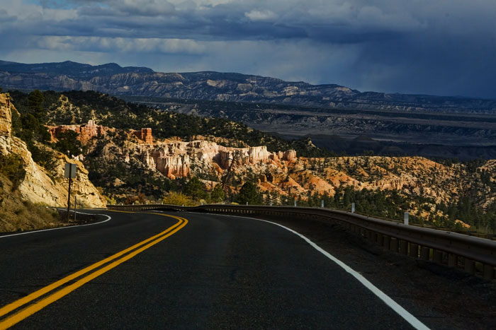 Landscape photo of road that leaves Bryce Canyon by Noella Ballenger