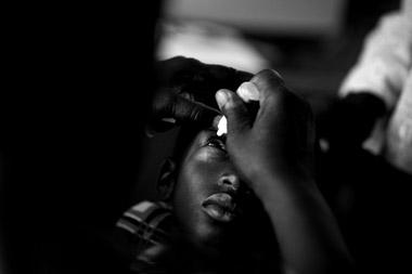 Photo portraid of Haddi getting eye exam, Ghana, Africa by Marielle van Uitert