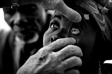 Photo portraid of Azara getting eye exam, Ghana, Africa by Marielle van Uitert