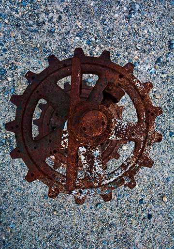 Close-up photo of rusty Gear showing earthy colors, shapes and textures by Brad Sharp.