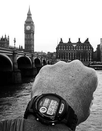 Image of wrist watch comparing time with Big Ben, London - Four Twenty Five O Four by Jim Austin.