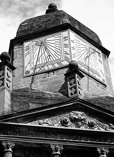 Kings College Sundial Clock, Tower Cambridge, England by Jim Austin.
