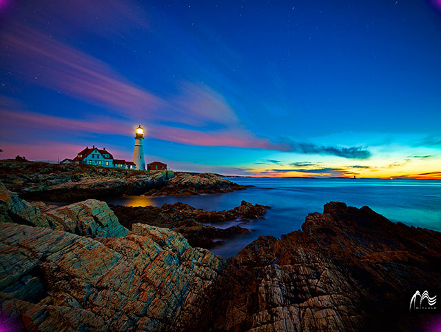 Seas of Tranquility: sunset image of rocky shore, sea and Portland Head Lighthouse in Cape Elizabeth, Maine by Jeff Mitchum.