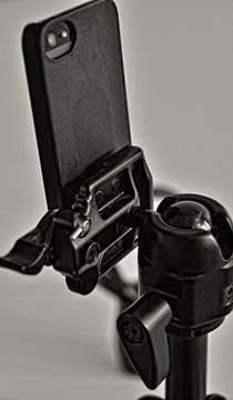 Image of smartphone mounted with Velcro on a tripod in a studio setting by Allen Moore.