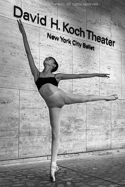 Black and white image of a young ballet dancer practicing in front of the David H. Koch Theater in New York City by Luca Venturi.