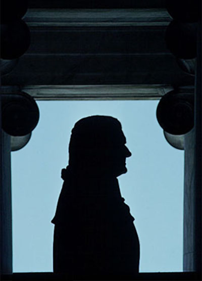 Silhouette of the Jefferson bust again blue sky at the Jefferson Memorial in Washington D.C. by Steve Gottlieb.