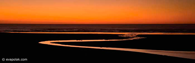 Image of S-curved water near ocean during an orange sunset showing flowing rhythm composition by Eva Polak.