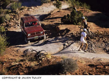 Image of a 4-wheel drive vehicle navigating its way on a rocky path by Noella Ballenger.