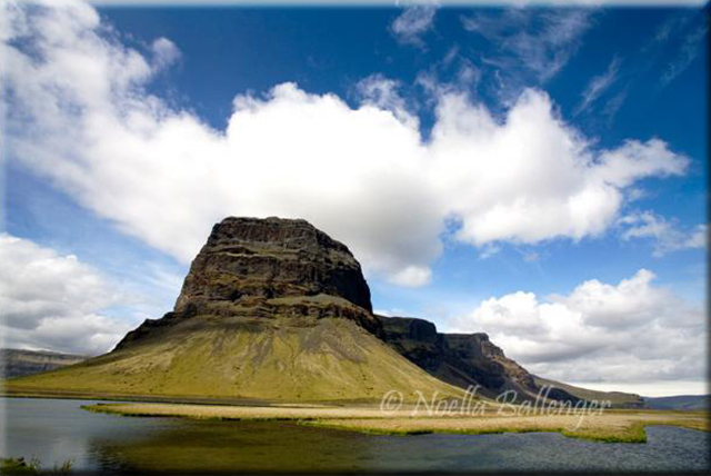 Photo of a rock formation with a flat top in Iceland by Noella Ballenger.