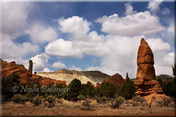 Photo of red rock formations and beautiful clouds at Kodachrome Basin in Utah by Noella Ballenger.