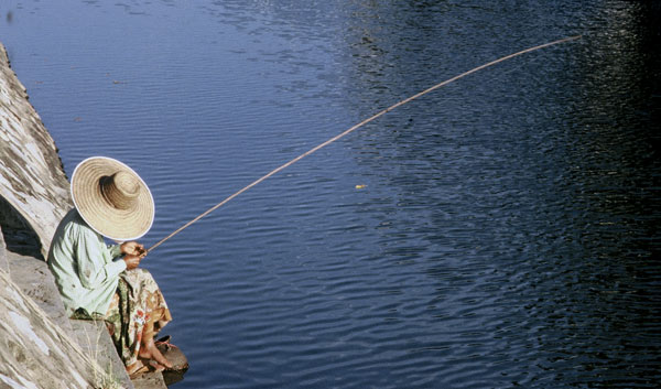 Photo of fishing in Chiang Mai, Thailand by Ron Veto