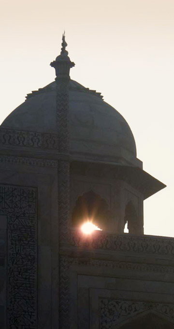 Partial silhouette photo of a tower of the Taj Mahal by Rick Clark