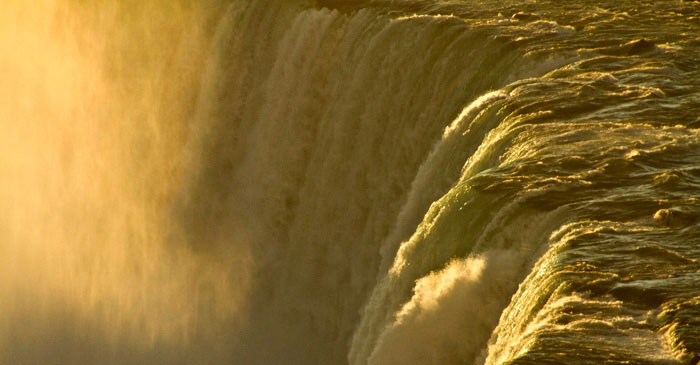 Image of golden light of dawn at Niagara Falls overlooking Horseshoe Falls, Ontario, Canada by Noella Ballenger.