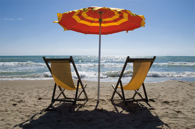 Photo of seascape, chairs and umbrella by Piero Leonardi