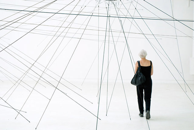 Photo of installation of springs and woman at Venice Biennale by Piero Leonardi