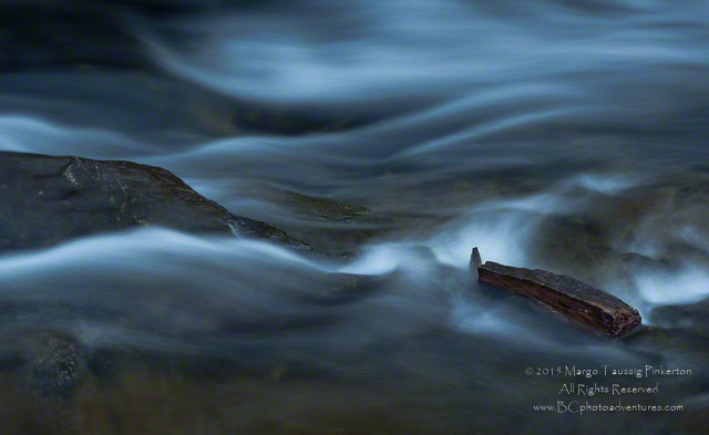 Image of silky flowing water in a stream made by using a slow shutter speed at the Blue Ridge Mountains, North Carolina by Margo Taussig Pinkerton.