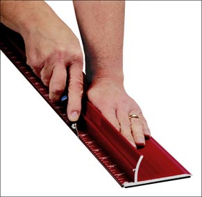 Image of SpeedPress' safety ruler demonstration Courtesy SpeedPress Sign SuppliesThe Speedpress.