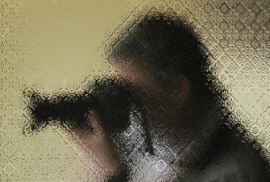 Photo of photographer behind glass
