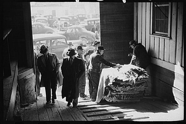Marion Post Wolcott's Arranging Tobacco Baskets in Mebane, N.C. photo