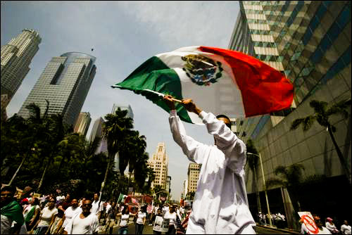 Photo of man with flag during 2007 protest in Los Angeles by Michelle Wong